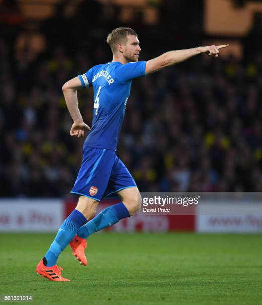 Per Mertesacker celebrates scoring a goal for Arsenal during the Premier League match between Watford and Arsenal at Vicarage Road on October 14 2017...