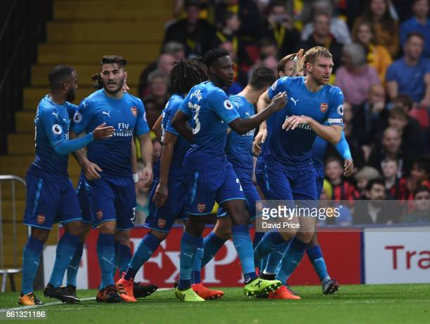 Per Mertesacker celebrates scoring a goal for Arsenal with Danny Welbeck during the Premier League match between Watford and Arsenal at Vicarage Road...