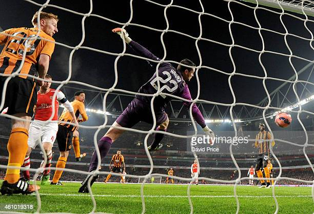 Per Mertesacker heads a goal for Arsenal past Steve Harper of Hull during the match between Arsenal and Hull City in the FA Cup 3rd Round at Emirates...