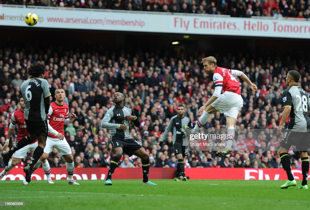 Per Mertesacker heads past Tottenham goalkeeper Hugo Lloris to score the 1st Arsenal goal during the Barclays Premier League match between Arsenal and Tottenham Hotspur, at Emirates Stadium on November 17, 2012 in London, England.