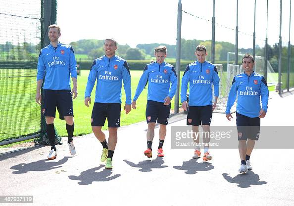 ALBANS ENGLAND MAY 3 Per Mertesacker Lukas Podolski Nacho Monreal Thomas Vermaelen and Santi Cazorla of Arsenal after a training session at London...