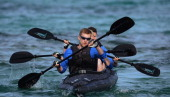 Per Mertesacker Marco Reus and Julian Draxler compete during a boat race of the German national football team outside the team hotel 'Romazzino' on...