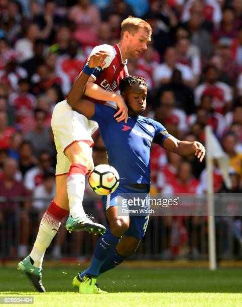 Per Mertesacker of Arsenal and Michy Batshuayi of Chelsea battle for possession during the The FA Community Shield final between Chelsea and Arsenal...