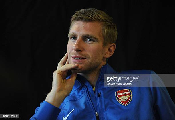 Per Mertesacker of Arsenal attends a tTV interview after a press conference at Stade Velodrome on September 17 2013 in Marseille