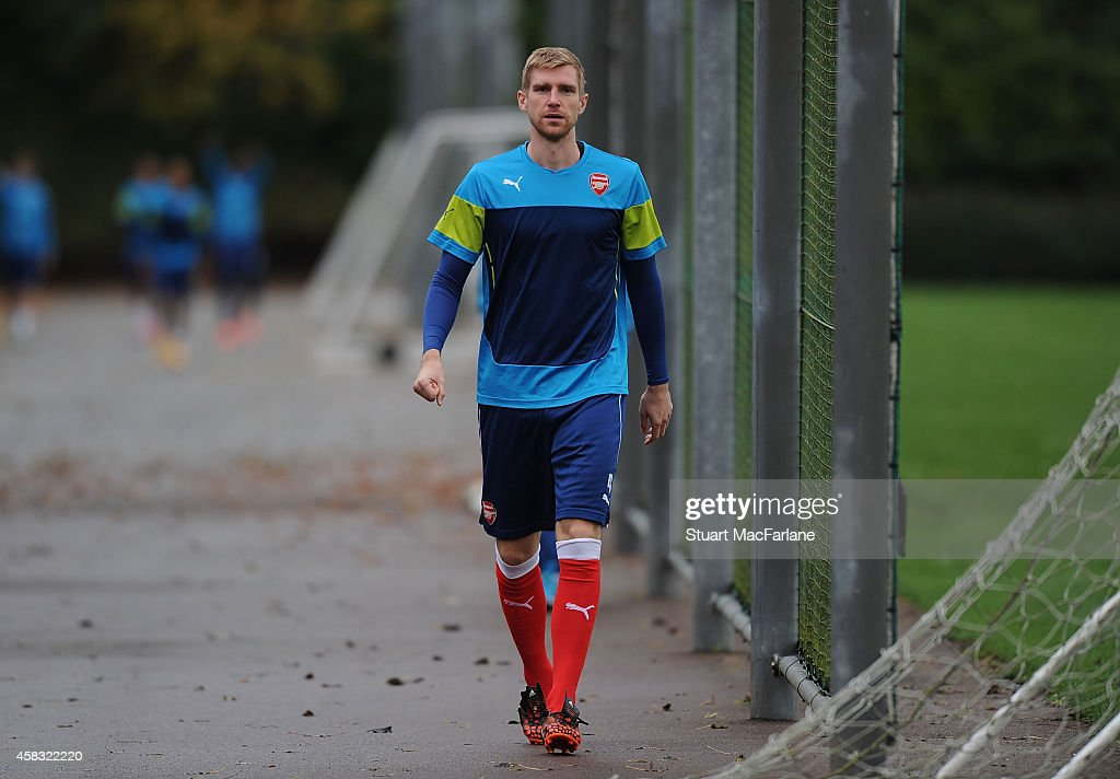 Per Mertesacker of Arsenal before a training session at London Colney on November 3, 2014 in St Albans, England. Photo by Stuart MacFarlane/Arsenal FC via Getty Images)