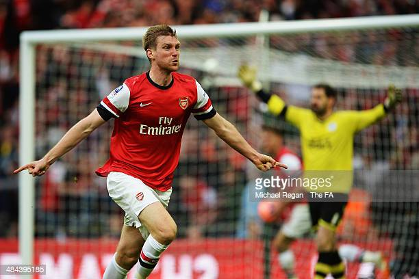 Per Mertesacker of Arsenal celebrates after scoring a goal during the FA Cup SemiFinal match between Wigan Athletic and Arsenal at Wembley Stadium on...