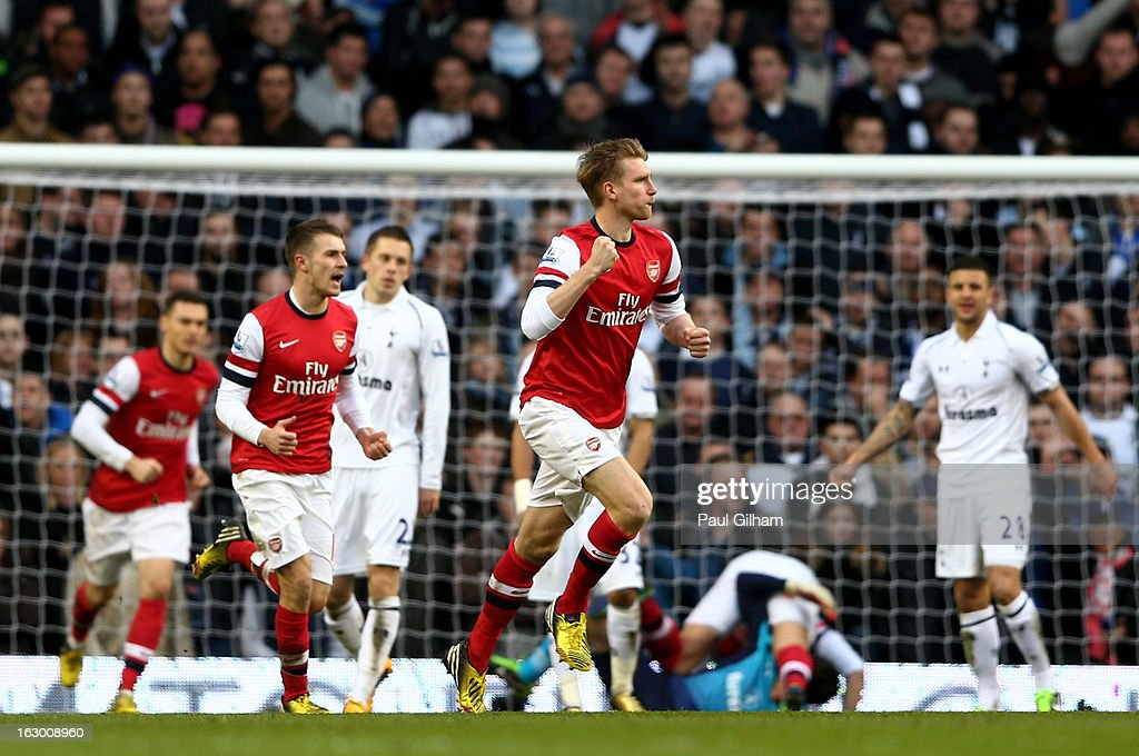 Per Mertesacker of Arsenal celebrates after scoring his team's first goal during the Barclays Premier League match between Tottenham Hotspur and Arsenal FC at White Hart Lane on March 3, 2013 in London, England.