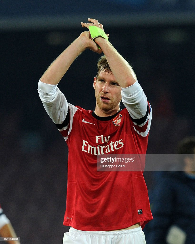 <a gi-track='captionPersonalityLinkClicked' href=/galleries/search?phrase=Per+Mertesacker&family=editorial&specificpeople=207135 ng-click='$event.stopPropagation()'>Per Mertesacker</a> of Arsenal celebrates after the UEFA Champions League Group F match between SSC Napoli and Arsenal at Stadio San Paolo on December 11, 2013 in Naples, Italy.