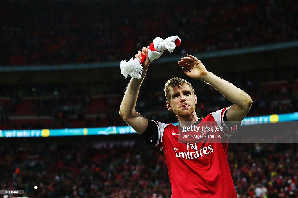 Per Mertesacker of Arsenal celebrates after winning the penalty shoot-out to claim victory in the FA Cup Semi-Final match between Wigan Athletic and Arsenal at Wembley Stadium on April 12, 2014 in London, England.
