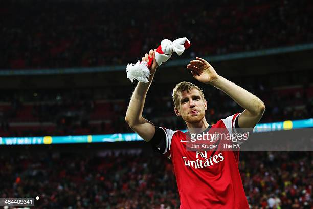 Per Mertesacker of Arsenal celebrates after winning the penalty shootout to claim victory in the FA Cup SemiFinal match between Wigan Athletic and...