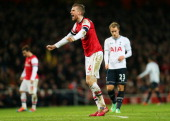 Per Mertesacker of Arsenal celebrates his team's 20 victory during the Budweiser FA Cup third round match between Arsenal and Tottenham Hotspur at...