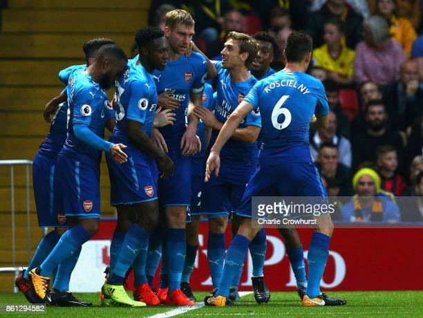 Per Mertesacker of Arsenal celebrates scoring her sides first goal during the Premier League match between Watford and Arsenal at Vicarage Road on...