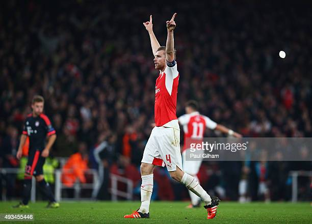 Per Mertesacker of Arsenal celebrates victory after the UEFA Champions League Group F match between Arsenal FC and FC Bayern Munchen at Emirates...