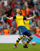 Per Mertesacker of Arsenal celebrates victory on the final whistle the FA Cup Final between Aston Villa and Arsenal at Wembley Stadium on May 30 2015...