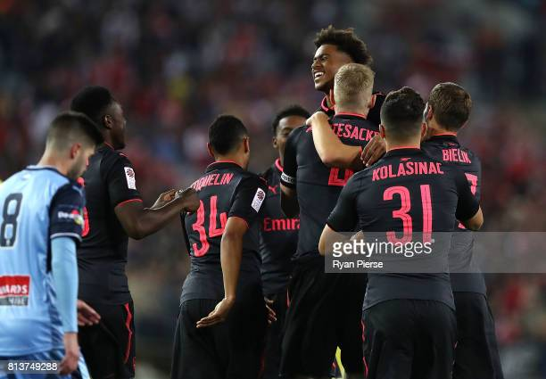 Per Mertesacker of Arsenal celebrates with Reiss Nelson of Arsenal after scoring his teams first goal during the match between Sydney FC and Arsenal...