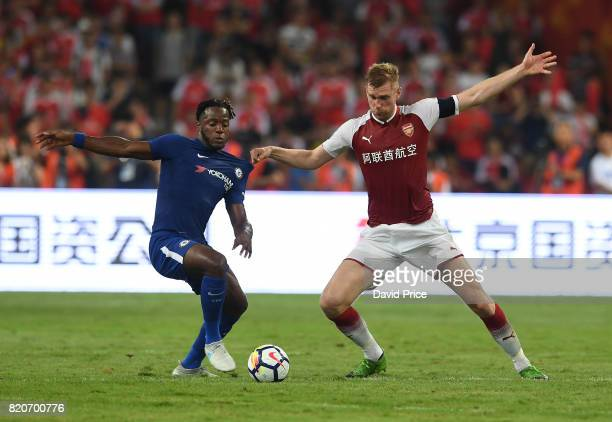 Per Mertesacker of Arsenal challenges Michy Batshuayi of Chelsea during the match between Arsenal and Chelsea at Birds Nest on July 22 2017 in...