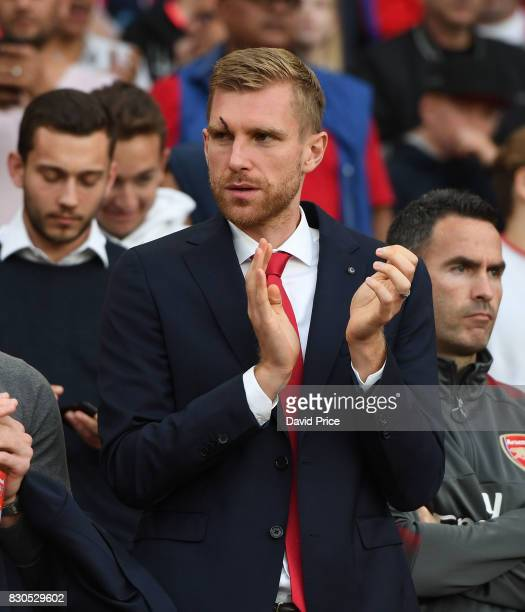 Per Mertesacker of Arsenal claps the teams onto the pitch before the Premier League match between Arsenal and Leicester City at Emirates Stadium on...