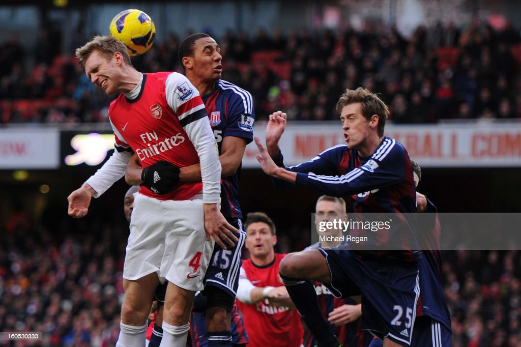 <a gi-track='captionPersonalityLinkClicked' href=/galleries/search?phrase=Per+Mertesacker&family=editorial&specificpeople=207135 ng-click='$event.stopPropagation()'>Per Mertesacker</a> of Arsenal competes for the ball against <a gi-track='captionPersonalityLinkClicked' href=/galleries/search?phrase=Steven+N%27Zonzi&family=editorial&specificpeople=6324480 ng-click='$event.stopPropagation()'>Steven N'Zonzi</a> and <a gi-track='captionPersonalityLinkClicked' href=/galleries/search?phrase=Peter+Crouch&family=editorial&specificpeople=210764 ng-click='$event.stopPropagation()'>Peter Crouch</a> of Stoke City during the Barclays Premier League match between Arsenal and Stoke City at Emirates Stadium on February 2, 2013 in London, England.