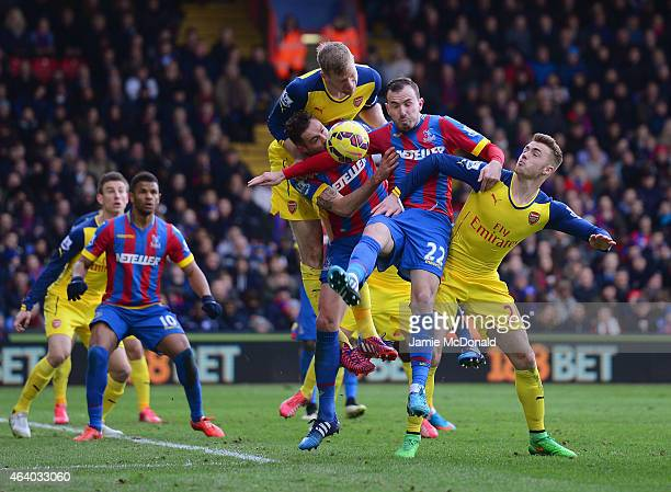 Per Mertesacker of Arsenal Damien Delaney of Crystal Palace Jordon Mutch of Crystal Palace and Calum Chambers of Arsenal battle for the ball during...