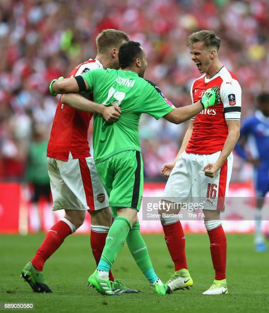 Per Mertesacker of Arsenal David Ospina of Arsenal and Rob Holding of Arsenal celebrate after the Emirates FA Cup Final between Arsenal and Chelsea...
