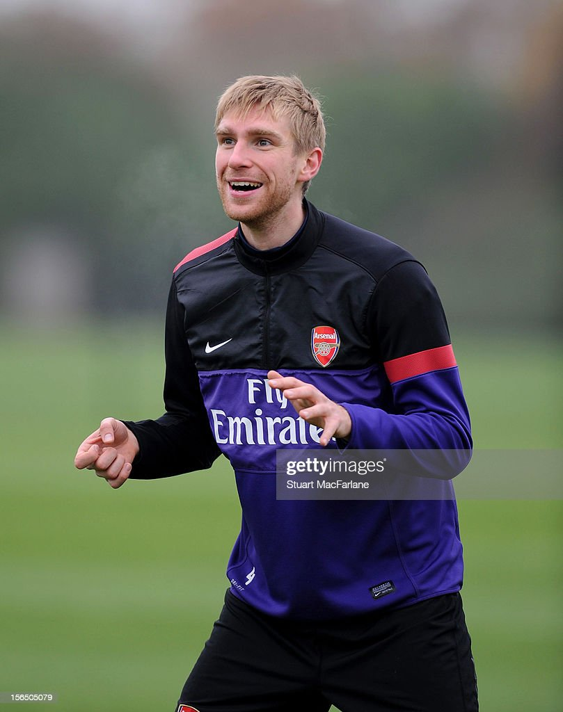 <a gi-track='captionPersonalityLinkClicked' href=/galleries/search?phrase=Per+Mertesacker&family=editorial&specificpeople=207135 ng-click='$event.stopPropagation()'>Per Mertesacker</a> of Arsenal during a training session at London Colney on November 16, 2012 in St Albans, England.