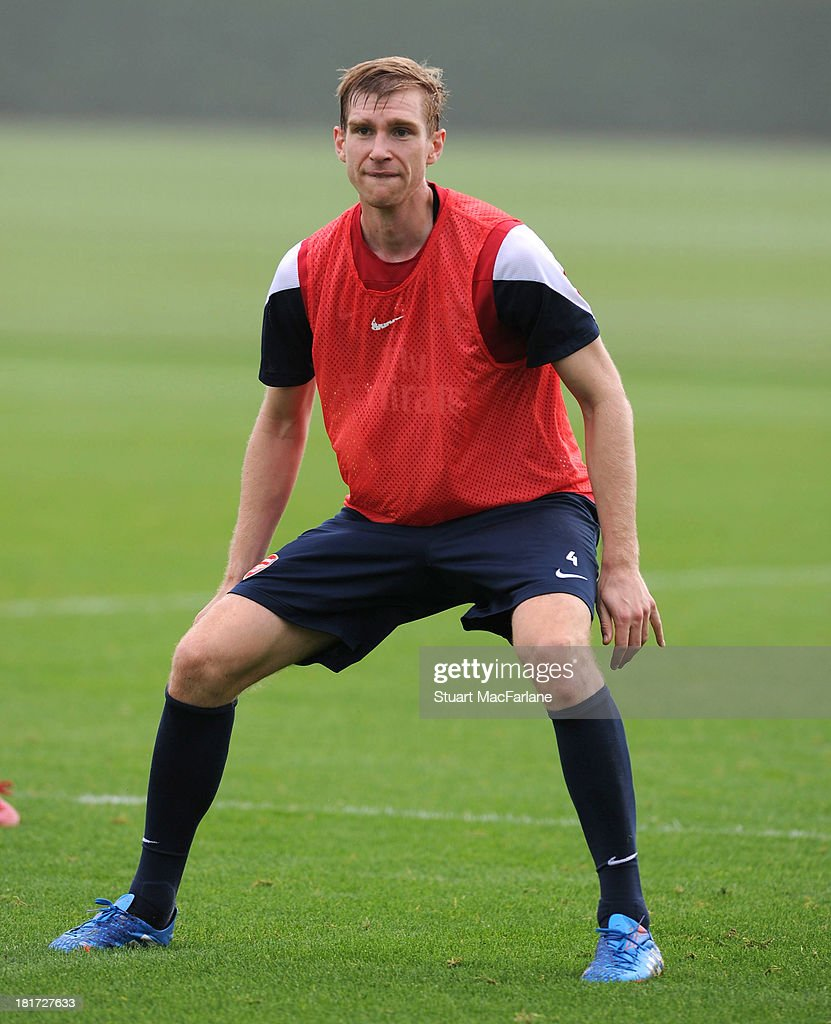<a gi-track='captionPersonalityLinkClicked' href=/galleries/search?phrase=Per+Mertesacker&family=editorial&specificpeople=207135 ng-click='$event.stopPropagation()'>Per Mertesacker</a> of Arsenal during a training session at London Colney on September 24, 2013 in St Albans, England.