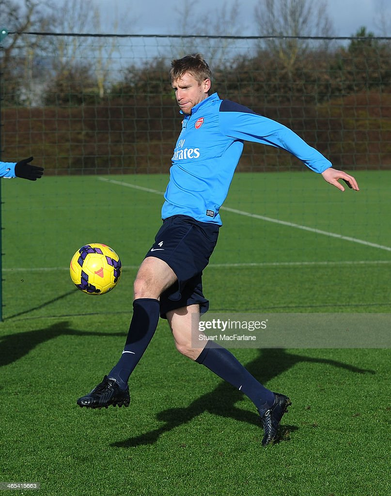 Per Mertesacker of Arsenal during a training session at London Colney on January 27, 2014 in St Albans, England.
