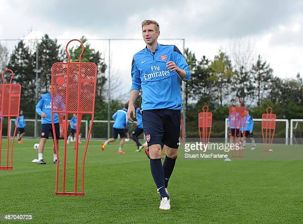 Per Mertesacker of Arsenal during a training session at London Colney on April 27 2014 in St Albans England