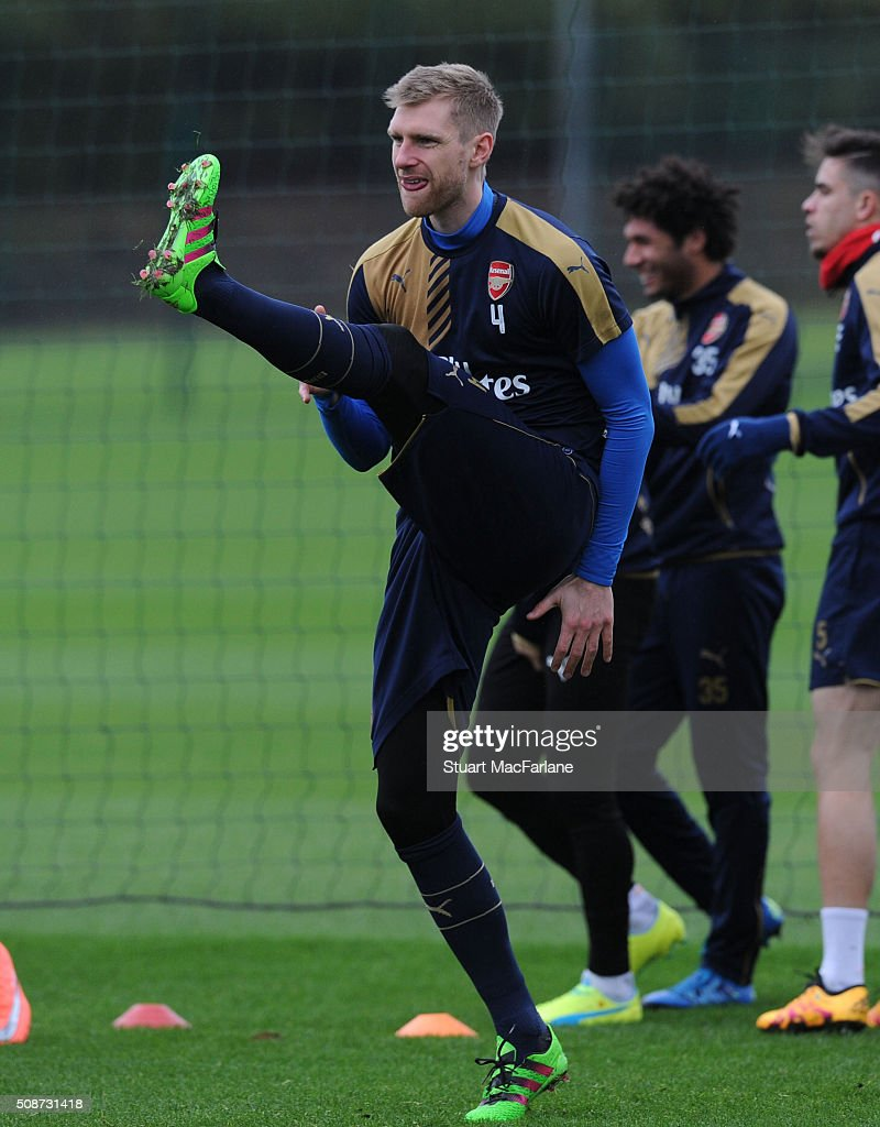 <a gi-track='captionPersonalityLinkClicked' href=/galleries/search?phrase=Per+Mertesacker&family=editorial&specificpeople=207135 ng-click='$event.stopPropagation()'>Per Mertesacker</a> of Arsenal during a training session at London Colney on February 6, 2016 in St Albans, England.