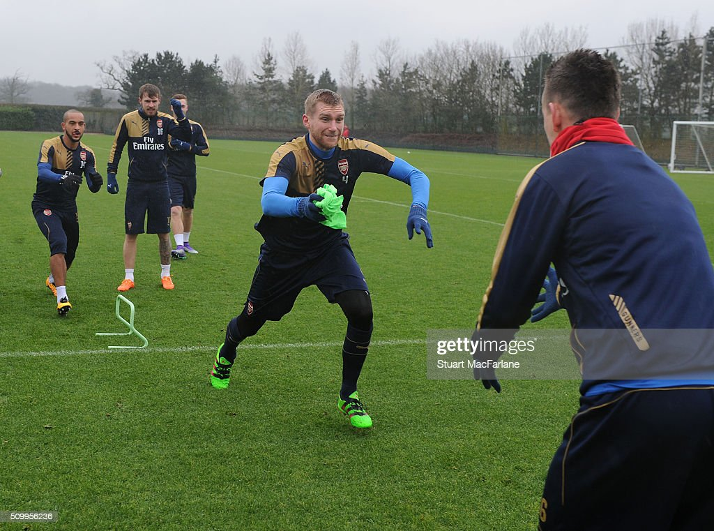 <a gi-track='captionPersonalityLinkClicked' href=/galleries/search?phrase=Per+Mertesacker&family=editorial&specificpeople=207135 ng-click='$event.stopPropagation()'>Per Mertesacker</a> of Arsenal during a training session at London Colney on February 13, 2016 in St Albans, England.