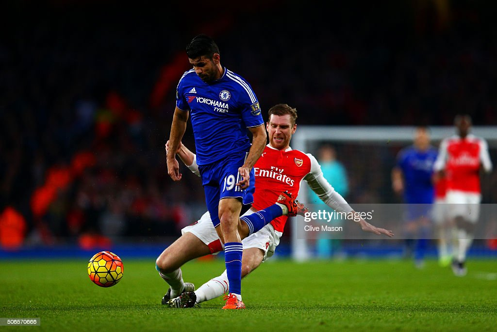 <a gi-track='captionPersonalityLinkClicked' href=/galleries/search?phrase=Per+Mertesacker&family=editorial&specificpeople=207135 ng-click='$event.stopPropagation()'>Per Mertesacker</a> of Arsenal fouls Diego Costa of Chelsea and subsequently receives a red card during the Barclays Premier League match between Arsenal and Chelsea at Emirates Stadium on January 24, 2016 in London, England.