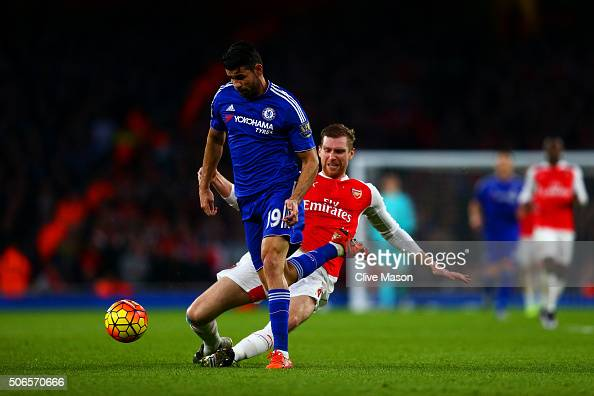 Per Mertesacker of Arsenal fouls Diego Costa of Chelsea and subsequently receives a red card during the Barclays Premier League match between Arsenal...