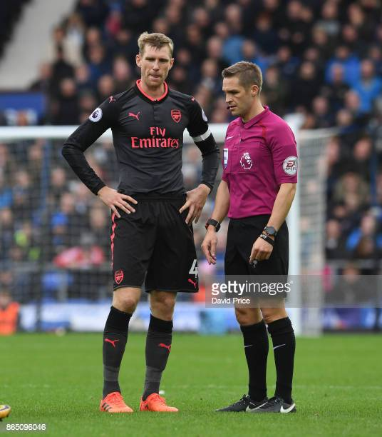Per Mertesacker of Arsenal has a word with Referee Criag Pawson during the Premier League match between Everton and Arsenal at Goodison Park on...