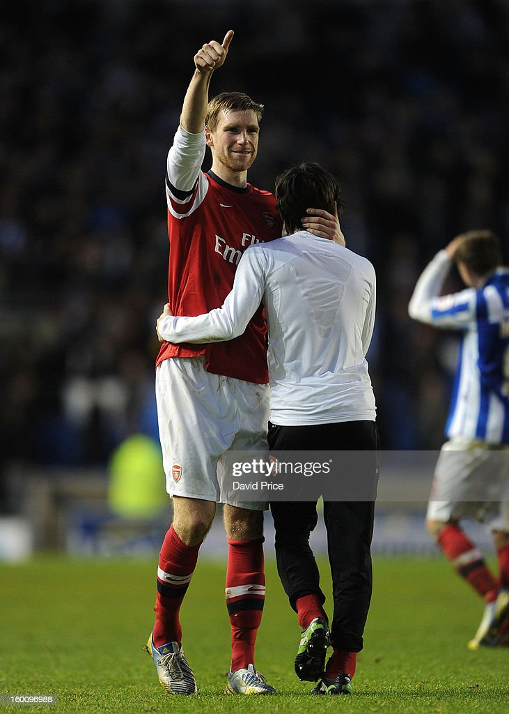 Per Mertesacker of Arsenal hugs Tomas Rosicky whilst giving the fans the thumbs up after the FA Cup Fourth Round match between Brighton & Hove Albion and Arsenal at the Amex Stadium on January 26, 2013 in Brighton, England.