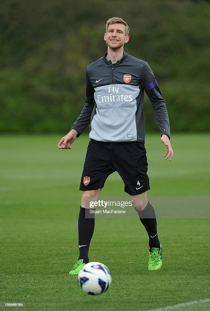 <a gi-track='captionPersonalityLinkClicked' href=/galleries/search?phrase=Per+Mertesacker&family=editorial&specificpeople=207135 ng-click='$event.stopPropagation()'>Per Mertesacker</a> of Arsenal in action during a training session at London Colney on May 18, 2013 in St Albans, England.