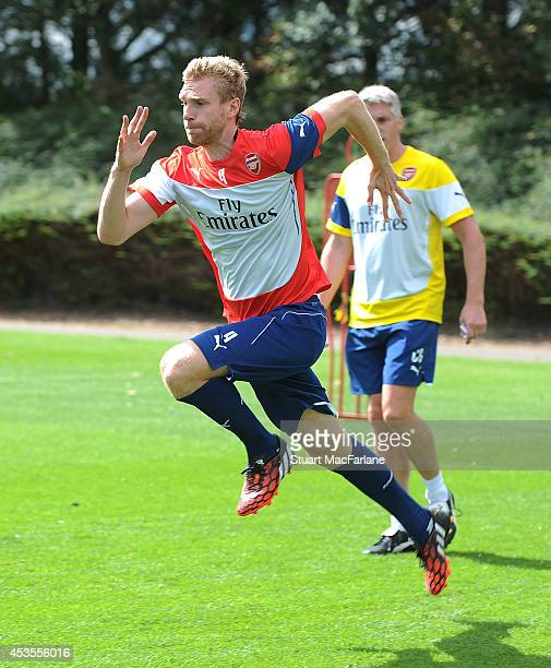 Per Mertesacker of Arsenal in action during a training session at London Colney on August 13 2014 in St Albans England