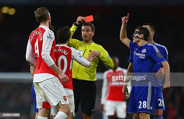 Per Mertesacker of Arsenal is shown the red card and is sent off for his challenge on Diego Costa of Chelsea during the Barclays Premier League match...
