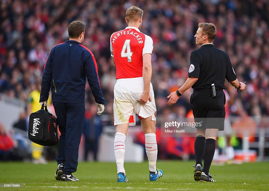 <a gi-track='captionPersonalityLinkClicked' href=/galleries/search?phrase=Per+Mertesacker&family=editorial&specificpeople=207135 ng-click='$event.stopPropagation()'>Per Mertesacker</a> of Arsenal leaves the field injured during the Barclays Premier League match between Arsenal and Norwich City at The Emirates Stadium on April 30, 2016 in London, England