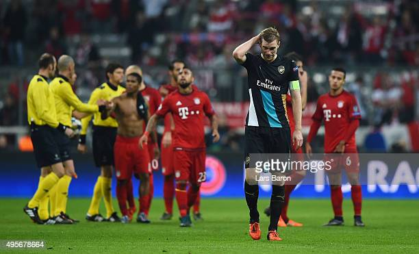 Per Mertesacker of Arsenal looks dejected following the final whistle during the UEFA Champions League Group F match between FC Bayern Muenchen and...