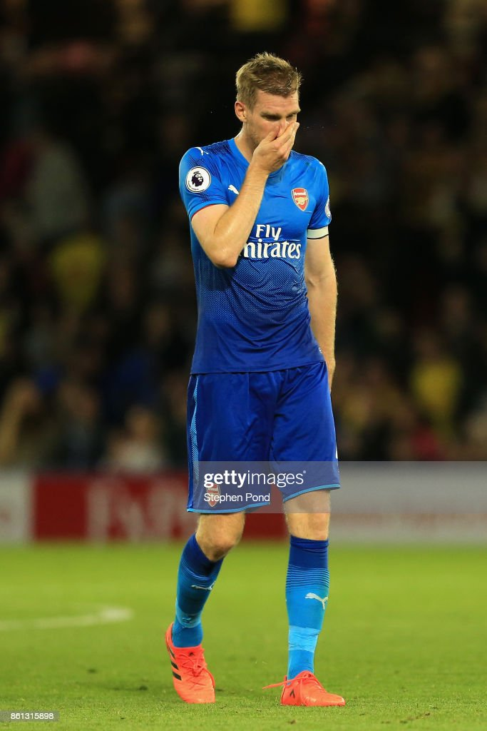 Per Mertesacker of Arsenal looks dejected in defence the Premier League match between Watford and Arsenal at Vicarage Road on October 14, 2017 in Watford, England.