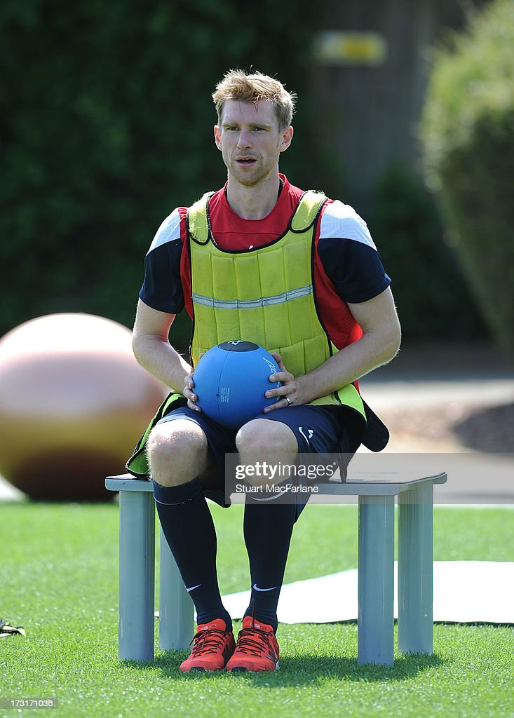Per Mertesacker of Arsenal looks on during a training session at London Colney on July 09, 2013 in St Albans, England.