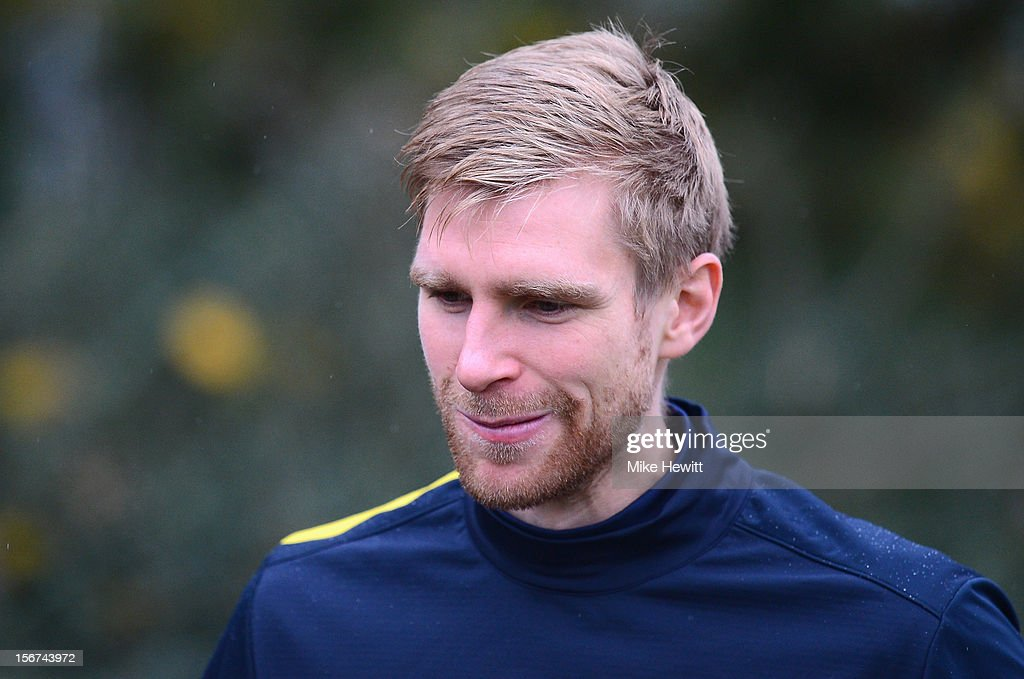Per Mertesacker of Arsenal looks on during a training session at London Colney ahead of tomorrow's UEFA Champions League Group B match against Montpellier on November 20, 2012 in St Albans, England.
