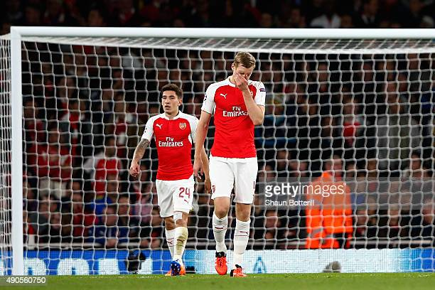 Per Mertesacker of Arsenal reacts after the third Olympiacos goal during the UEFA Champions League Group F match between Arsenal FC and Olympiacos FC...