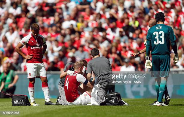 Per Mertesacker of Arsenal receives treatment before leaving the pitch during the The FA Community Shield between Chelsea and Arsenal at Wembley...