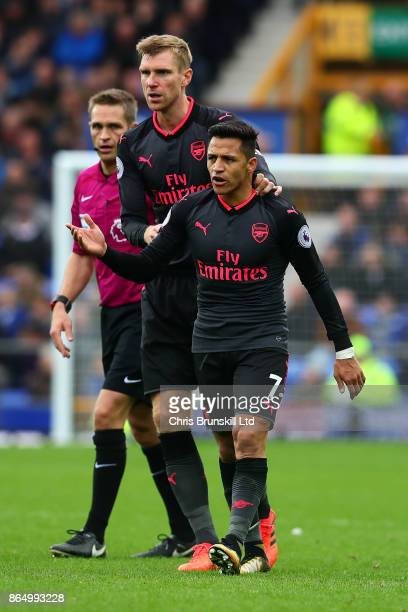 Per Mertesacker of Arsenal remonstrates with teammate Alexis Sanchez during the Premier League match between Everton and Arsenal at Goodison Park on...
