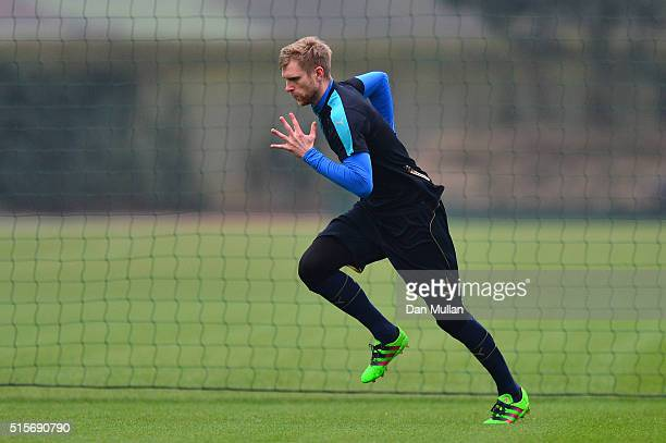 Per Mertesacker of Arsenal runs during a training session ahead of the UEFA Champions League round of 16 second leg match between Barcelona and...
