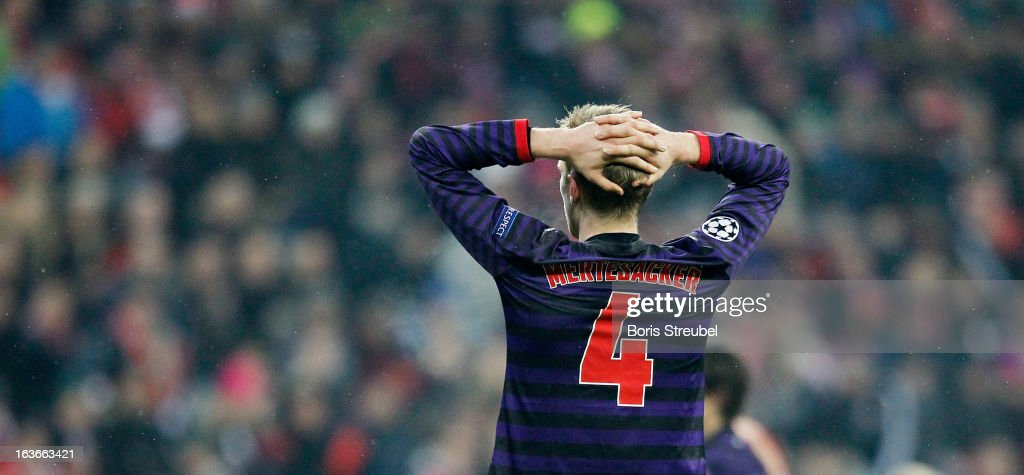 Per Mertesacker of Arsenal shows his frustration after loosing the UEFA Champions League Round of 16 second leg match between Bayern Muenchen and Arsenal FC at Allianz Arena on March 13, 2013 in Munich, Germany.