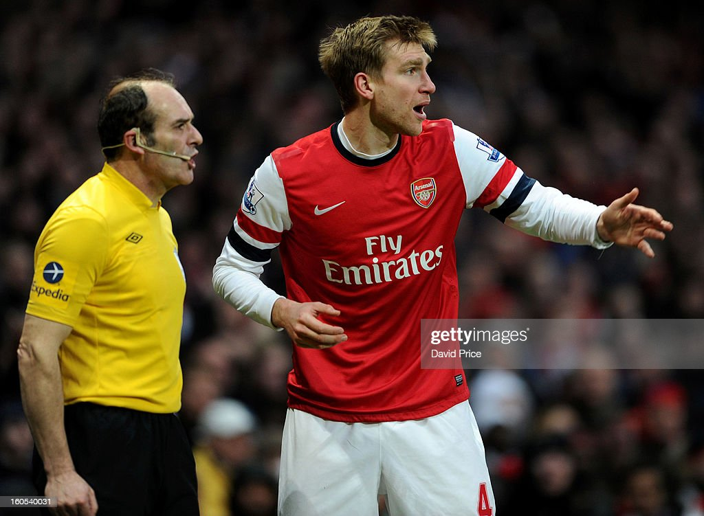 Per Mertesacker of Arsenal speaks to the linesman who put his flag up to rule out the Arsenal goal during the Barclays Premier League match between Arsenal and Stoke City at Emirates Stadium on February 02, 2013 in London, England.
