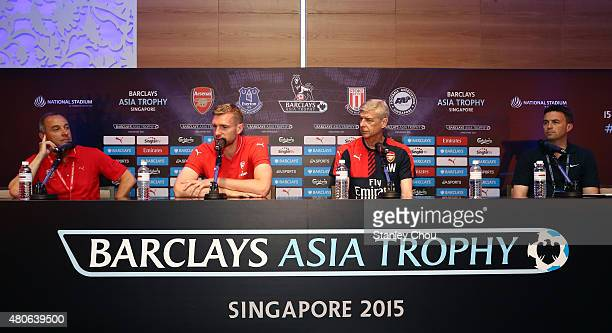 Per Mertesacker of Arsenal speaks while Arsene Wenger manager of Arsenal looks on during the prematch press conference ahead of the match between...