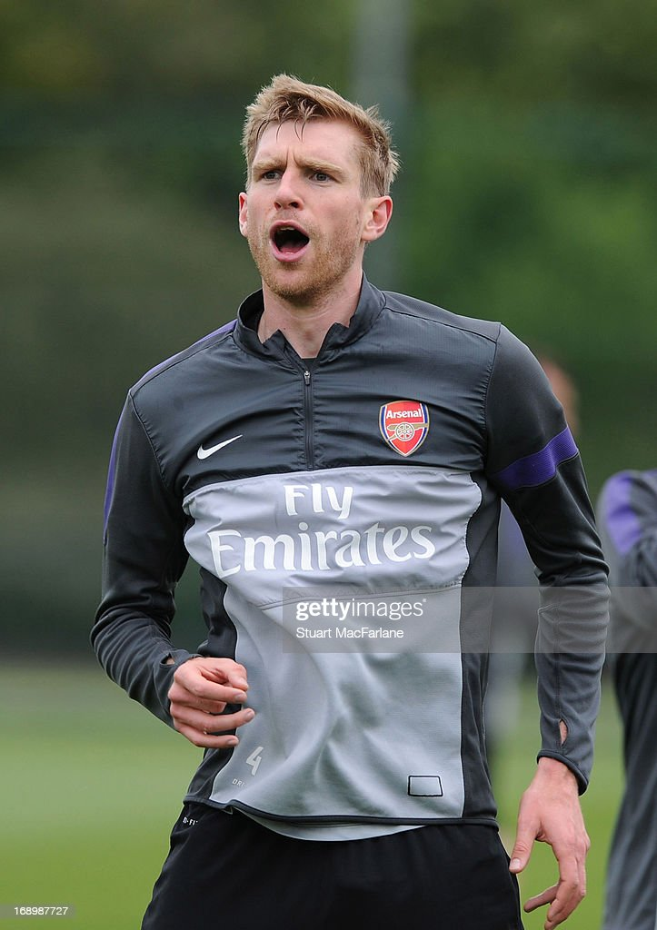 Per Mertesacker of Arsenal take part in a training session at London Colney on May 18, 2013 in St Albans, England.